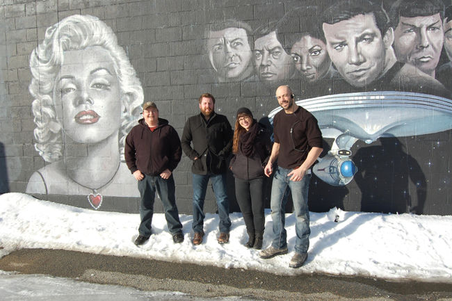 In this file photo, William Andrews, head of operations with Hideaway Pictures, David Anselmo, the company's CEO, Melissa Cormier, an art director on their film The Frozen and Bruno Rocca, the first assistant art director stand next to the studio's movie themed mural. The Sudbury Star